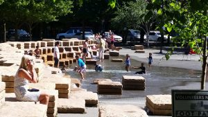 Playing in fountain at Jamison Square