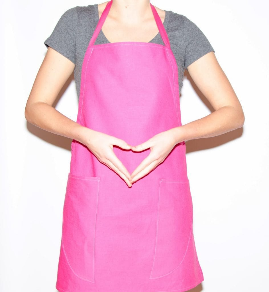 Pink Apron Hands Making Heart Shape