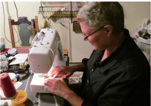 Lori Schumann at Sewing Machine