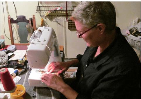 Lori Schumann at Sewing Machine