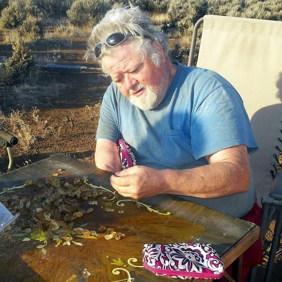 Ann's Dad sorting sunstones